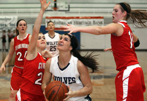 photo - Claremore&#039;s Miranda Taylor , right, and teammates defend a shot attempt by Shawnee&#039;s Taylor Cooper during a girls&#039; Class 5A state basketball tournament game Thursday, March 8, 2012, in Sapulpa, Okla. (AP Photo/Tulsa World, Cory Young) ORG XMIT: OKTUL402