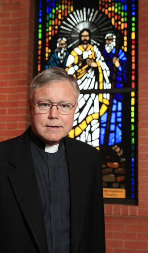 Photo - The Rev. Bill Pruett is pastor at St. James Catholic Church. Photo by PAUL B. SOUTHERLAND, The Oklahoman