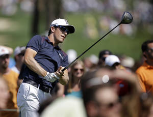 Photo - Scott Langley watches his tee shot on the 15th hole during the third round of the Memorial golf tournament Saturday, May 31, 2014, in Dublin, Ohio. (AP Photo/Darron Cummings)