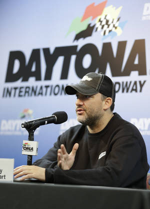 Photo - NASCAR driver Tony Stewart answers questions at a news conference during Sprint Cup auto racing testing at Daytona International Speedway in Daytona Beach, Fla., Thursday, Jan. 9, 2014.(AP Photo/John Raoux)