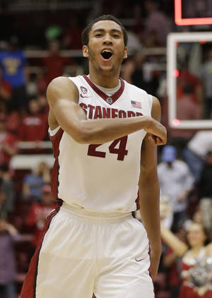 Photo - Stanford forward Josh Huestis (24) celebrates after an 83-74 win over UCLA during the second half of an NCAA college basketball game on Saturday, Feb. 22, 2014, in Stanford, Calif. (AP Photo/Marcio Jose Sanchez)