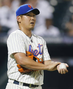 Photo - New York Mets starting pitcher Daisuke Matsuzaka (16) reacts after giving up a double to Philadelphia Phillies' Michael Young in the fifth inning of a baseball game at Citi Field in New York, Wednesday, Aug. 28, 2013. (AP Photo/Paul J. Bereswill)