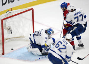 Photo - Montreal Canadiens left wing Max Pacioretty (67) scores the winning goal against Tampa Bay Lightning goalie Kristers Gudlevskis (37) during third period National Hockey League Stanley Cup playoff action on Tuesday, April 22, 2014 in Montreal. (AP Photo/The Canadian Press, Ryan Remiorz)