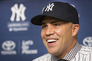 Photo - Carlos Beltran smiles during a news conference at Yankees Stadium, Friday, Dec. 20, 2013, in New York. The former St. Louis Cardinals outfielder signed with the New York Yankees on a $45 million, three-year contract. (AP Photo/John Minchillo)