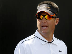 Photo - OKLAHOMA STATE UNIVERSITY / COLLEGE FOOTBALL: Oklahoma State coach Mike Gundy gets ready to take the field after halftime of OSU's spring football game at Boone Pickens Stadium in Stillwater, Okla., Sat., April 20, 2013. Photo by Bryan Terry, The Oklahoman