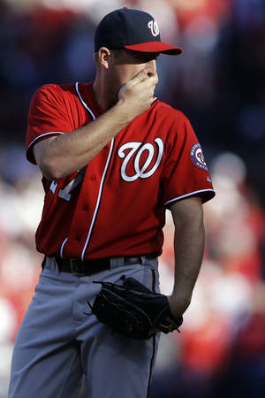 Photo -   Washington Nationals starting pitcher Jordan Zimmermann stands on the mound after giving up a double to St. Louis Cardinals' David Freese during the second inning in Game 2 of baseball's National League division series, Monday, Oct. 8, 2012, in St. Louis. (AP Photo/Jeff Roberson)