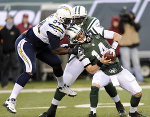 photo - New York Jets quarterback Greg McElroy, right, is sacked by San Diego Chargers defensive end Corey Liuget, left, during the second half of an NFL football game on Sunday, Dec. 23, 2012, in East Rutherford, N.J. The Chargers won 27-17. (AP Photo/Bill Kostroun)