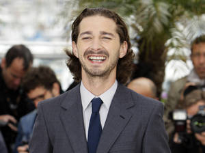 "Photo -   FILE- In this May 19, 2012, file photo, actor Shia LaBeouf poses during a photo call for Lawless at the 65th international film festival, in Cannes, southern France. Sigur Ros' new video ""Fjogur Piano"" released Monday, June, 18, features LeBeouf. The video was directed by Alma Har'el and is part of a series of videos being created for the band's latest album ""Valtari."" (AP Photo/Francois Mori, File)"