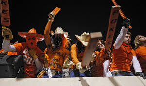 Photo - Cowboy fans cheer on their team during the Bedlam college football game between the University of Oklahoma Sooners (OU) and the Oklahoma State University Cowboys (OSU) at Boone Pickens Stadium in Stillwater, Okla., Saturday, Nov. 27, 2010. Photo by Chris Landsberger, The Oklahoman