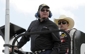 Photo - Team owner Richard Childress, front, and driver Austin Dillon, back, watch practice for Saturday's NASCAR Sprint Cup series auto race at Charlotte Motor Speedway in Concord, N.C., Friday, May 16, 2014. (AP Photo/Mike McCarn)