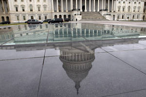 photo - FILE - In this Tuesday, Jan. 1, 2013, file photo, the dome of the Capitol is reflected in a skylight of the Capitol Visitor's Center in Washington. By delaying hard choices on spending, the fiscal cliff deal guaranteed more confrontation and uncertainty this year, especially when Congress must vote later this winter to raise the government's borrowing limit. That's likely to keep businesses cautious about hiring and investing. (AP Photo/Jacquelyn Martin, File)