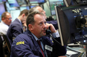 Photo -   Broker Paul A. Mandile works the trading floor of the New York Stock Exchange short time after the opening bell at the New York Stock Exchange up Thursday, Sept.. 6, 2012 (AP Photo/David Karp)