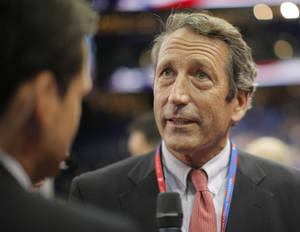 Photo - FILE - In this Aug. 28, 2012 file photo, former South Carolina Gov. Mark Sanford talks to a reporter in the floor at the Republican National Convention in Tampa, Fla. Nearly four years after his affair with an Argentine woman was exposed, Sanford plans to announce his return to politics and run for his old congressional seat on Wednesday, Jan. 16, 2013. (AP Photo/Charles Dharapak, File)
