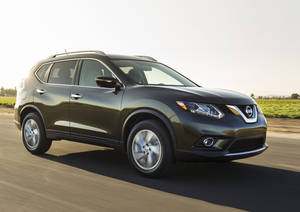 Photo - This undated product image provided by Nissan North America shows the 2014 Nissan Rogue small SUV. American car buyers came out of hibernation in April to spend on pickup trucks and SUVs, fueling an auto sales rebound that analysts expect to last the rest of the year. Nissan led the way with an 18.3 percent increase over a year ago, with sales of the redesigned Rogue up almost 27 percent. (AP Photo/Nissan North America)