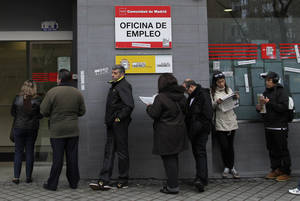 Photo - People wait outside an unemployment office in Madrid, Spain, Tuesday, April 2, 2013. Spanish government figures show that the number of people registered as unemployed edged down by a little under 5,000 in March, the first reduction for the month in five years. The scale of the task remains huge though as the number registered as unemployed stands at 5.04 million. Spain is battling to emerge from its second recession in just over three years. (AP Photo/Andres Kudacki)
