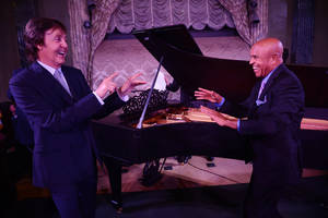 Photo -   In this Tuesday, Sept. 18, 2012 photo provided by the Motown Museum, Paul McCartney, left, and Berry Gordy stand in front of a newly restored 1877 Steinway grand piano during a benefit at the Motown Museum at Steinway Hall in New York. The piano, used by Motown greats during the label's heyday, was restored with an assist by McCartney. (AP Photo/Motown Museum, Shahar Azran) MANDATORY CREDIT