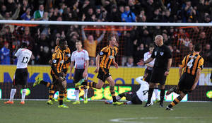 Photo - Hull City's David Meyler, centre, celebrates after scoring his team's second goal during the English Premier League match between Hull City and Liverpool at the KC Stadium, Hull, England, Sunday, Dec . 1, 2013. (AP Photo/PA, Anna Gowthorpe) UNITED KINGDOM OUT, NO SALES, NO ARCHIVE