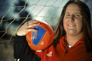 photo - Former soccer player Lauren Long's series of concussions that have left her with memory and concentration problems that she will never recover from.  Photo by Chris Landsberger, The Oklahoman