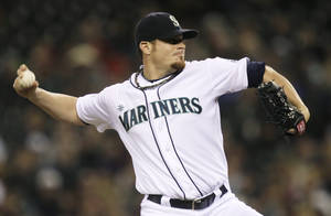 Photo -   Seattle Mariners starting pitcher Blake Beavan throws in the seventh inning of a baseball game against the Texas Rangers, Saturday, Sept. 22, 2012, in Seattle. (AP Photo/Ted S. Warren)