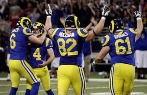 photo - St. Louis Rams kicker Greg Zuerlein (4) is congratulated by Johnny Hekker, left, after making a 54-yard field goal to defeat the San Francisco 49ers 16-13 in overtime of an NFL football game, Sunday, Dec. 2, 2012, in St. Louis. Running past are Rams' Matthew Mulligan (82) and Tim Barnes (61). (AP Photo/Tom Gannam)