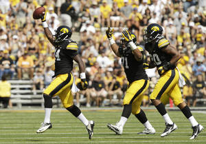 Photo - Iowa defensive back Desmond King, left, celebrates with teammates after recovering a fumble during the first half of an NCAA college football game against Missouri State, Saturday, Sept. 7, 2013, in Iowa City, Iowa. (AP Photo/Charlie Neibergall)