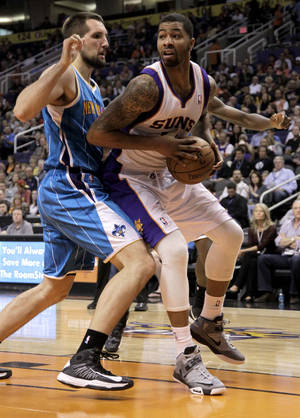 Photo -   Phoenix Suns' Markieff Morris, right, drives against New Orleans Hornets' Ryan Anderson during the second half on an NBA game, Friday, Nov. 23, 2012, in Phoenix. (AP Photo/Matt York)