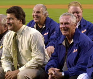 Photo -   FILE - In this Aug. 17, 2002, file photo, former New York Mets players, from left, Keith Hernandez, Ed Kranepool, Buddy Harrelson and Rusty Staub smile during the Mets 40th Anniversary Celebration All Amazin' Team prior to the Mets game against the Los Angeles Dodgers in New York. The New York Mets are the subject of a three-day academic conference taking place at Hofstra University. The conference features former players from Rusty Staub to Ed Kranepool. There will be panel discussions by sports journalists and baseball historians, bloggers, biographers and will run through Saturday, April 28, 2012. (AP Photo/Osamu Honda, File)
