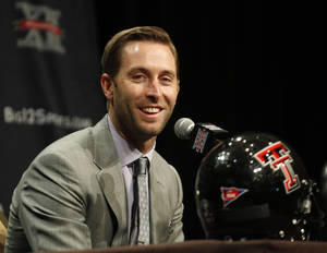 Photo - Texas Tech coach Kliff Kingsbury made his own visit to ESPN earlier this summer. He also visited the offices of Sports Illustrated. AP photo