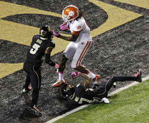 Photo -   Clemson's DeAndre Hopkins, right, catches a touchdown pass as Wake Forest's Daniel Mack, left, and Merrill Noel, bottom, defend during the first half of an NCAA college football game in Winston-Salem, N.C., Thursday, Oct. 25, 2012. (AP Photo/Chuck Burton)