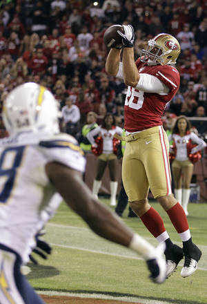 Photo -   San Francisco 49ers tight end Garrett Celek (48) catches a touchdown pass from quarterback Josh Johnson against the San Diego Chargers during the second half of an NFL preseason football game in San Francisco, Thursday, Aug. 30, 2012. (AP Photo/Ben Margot)