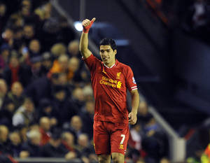 Photo - Liverpool's Luis Suarez celebrates after scoring the second goal of the game during their English Premier League soccer match against Norwich City at Anfield in Liverpool, England, Wednesday Dec. 4, 2013. (AP Photo/Clint Hughes)