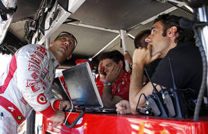 Photo - Tony Kanaan, of Brazil, left, talks with former teammate and pace car driver Dario Franchitti, right, of Scotland, on the final day of practice for the Indianapolis 500 IndyCar auto race at the Indianapolis Motor Speedway in Indianapolis, Friday, May 23, 2014. The 98th running of the Indianapolis 500 is Sunday. (AP Photo/Tom Strattman)