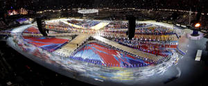Photo -   Athletes enter the Olympic Stadium during the Closing Ceremony at the 2012 Summer Olympics, Sunday, Aug. 12, 2012, in London. (AP Photo/David J. Phillip)