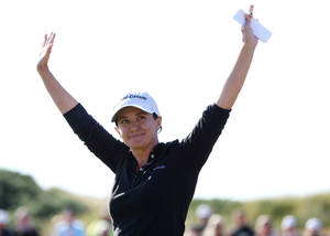 Photo - Mo Martin of the U.S celebrates after winning the Women's British Open golf championship at the Royal Birkdale Golf Club, in Southport, England, Sunday, July 13, 2014. (AP Photo/Scott Heppell)