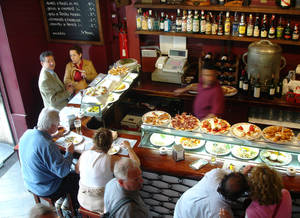 Photo - Tempting plates in Spain's tapas bars make it easy to sample new foods. Photo by Rick Steves <strong>Photo by Rick Steves</strong>
