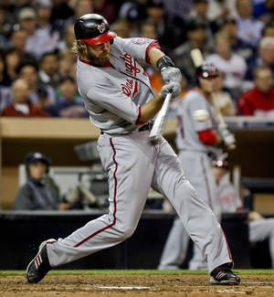 Photo -   Washington Nationals' Jayson Werth connects for a solo home run against the San Diego Padres in the seventh inning of a baseball game Thursday, April 26, 2012, in San Diego. (AP Photo/Lenny Ignelzi)