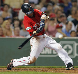 Photo -   Boston Red Sox's Dustin Pedroia hits a one-run single in the fifth inning of a baseball game against the Toronto Blue Jays in Boston, Friday, Sept. 7, 2012. (AP Photo/Michael Dwyer)
