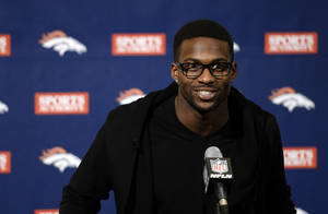 Photo - Emmanuel Sanders speaks during an NFL football news conference Sunday, March 16, 2014, in Englewood, Co. Sanders signed a three-year, $15 million contract with the Denver Broncos. (AP Photo/The Denver Post, John Leyba) MAGS OUT; TV OUT; INTERNET OUT; NO SALES; NEW YORK POST OUT; NEW YORK DAILY NEWS OUT