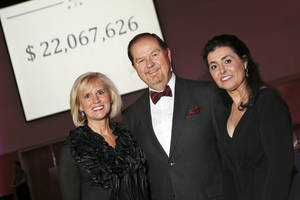 Photo - From left, campaign co-chairs Donna Lawrence and Bruce Lawrence with United Way of Central Oklahoma CEO and president Debby Hampton pose for a photo with the fundraising total of $22,067,626 during the United Way of Central Oklahoma Snowflake Gala at the National Cowboy & Western Heritage Museum in Oklahoma City on Friday. <strong>NATE BILLINGS</strong>