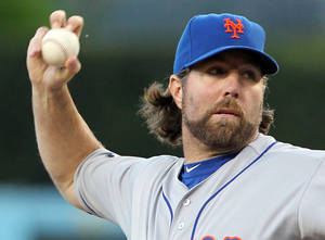 photo - R.A. Dickey, the New York Mets' knuckleball specailist, pitches to the Los Angeles Dodgers in the first inning of a baseball game at Dodger Stadium in Los Angeles Friday, June 29, 2012. Dickey allowed three hits over eight innings to become the major leagues' first 12-game winner, Daniel Murphy drove in five runs and the New York Mets sent the Los Angeles Dodgers to their season-worst sixth straight loss with an 9-0 victory Saturday night.(AP Photo/Reed Saxon) ORG XMIT: LAD111