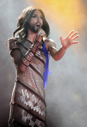 Photo - Austrian singer and Eurovision Song Contest winner Conchita Wurst performs on stage during the opening ceremony of the Life Ball in front of City Hall in Vienna, Austria, Saturday, May 31, 2014. The Life Ball is a charity gala to raise money for people living with HIV and AIDS. (AP Photo/Ronald Zak)
