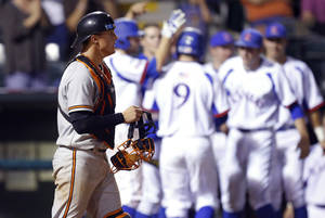 Oklahoma State's Gage Green looks up as Kansas celebrates a run in the seventh inning of their Big 12 Baseball Championship tournament game at the Chickasaw Bricktown Ballpark in Oklahoma City, Friday, May, 24, 2013. Photo by Bryan Terry, The Oklahoman