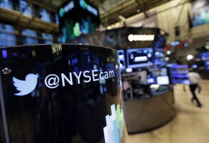 Photo - FILE - In this  Monday, Nov. 4, 2013, file photo, an updated phone post on the floor of the New York Stock Exchange features a Twitter logo, in New York. Twitter Inc. reports quarterly earnings on Wednesday, Feb. 5, 2014. (AP Photo/Richard Drew)
