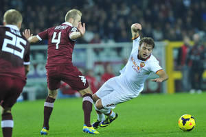 Photo - AS Roma forward Adem Liajic, of Serbia, right, vies for the ball with F.C. Torino defender Migjen Basha, of Switzerland, during their Serie A soccer match at Turin's Olympic stadium, Italy, Sunday, Nov. 3, 2013. (AP Photo/Massimo Pinca)