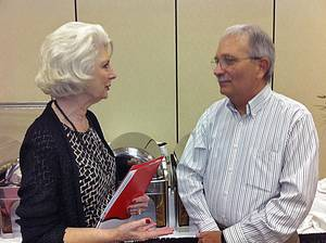 Photo - Author Michael Thomas visits with Edmond interior designer Carolyn Sandusky about at the 2012 Senior Summit held Tuesday in Oklahoma City. <strong>Provided - Provided</strong>