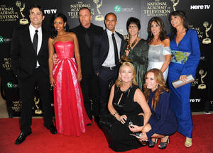 "Photo - The cast and crew of ""The Young and the Restless"" poses in the press room with the award for outstanding drama series at the 41st annual Daytime Emmy Awards at the Beverly Hilton Hotel on Sunday, June 22, 2014, in Beverly Hills, Calif. (Photo by Richard Shotwell/Invision/AP)"