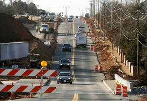 Photo - Two lanes of Kelly Avenue, between Covell and Coffee Creek roads, are opened again. The road has been closed since July. PHOTO BY PAUL HELLSTERN, THE OKLAHOMAN. <strong>PAUL HELLSTERN - THE OKLAHOMAN</strong>