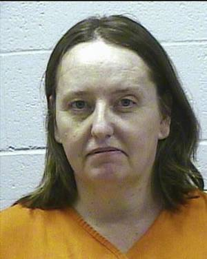Photo - In this photo provided by the Oklahoma Department of Corrections, Bobbi Parker is pictured in a prison photo dated Nov. 15, 2011. The former prison warden's wife, who was convicted of helping a convicted killer escape, is tentatively scheduled to be released next month. (AP Photo/Oklahoma Department of Corrections)