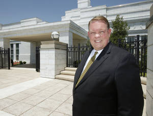 Photo - Kevin Graves, a leader with the Oklahoma City Stake of the Church of Jesus Christ of Latter-day Saints, poses in front of the LDS Surrey Hills Temple in Yukon, OK, Tuesday, July 5, 2011. By Paul Hellstern, The Oklahoman ORG XMIT: KOD