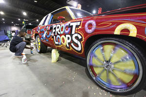 "Photo - ""Snap"" puts the finishing touches on his ""Froot Loops"" car during the Car and Bike Show at State Fair Park in Oklahoma City, OK, Saturday, August 17, 2013,  Photo by Paul Hellstern, The Oklahoman"